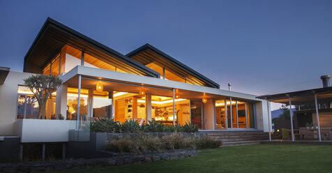Illuminated luxury modern house at night - HOXF00256