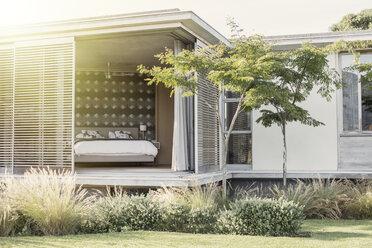 Shutter patio doors open to luxury bedroom - HOXF00280
