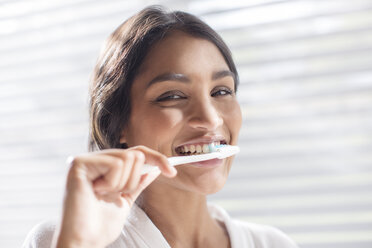 Close up portrait smiling woman brushing teeth - HOXF00295