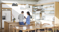 Couple using digital tablet in kitchen - HOXF00301