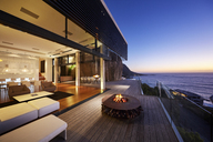 Fire pit on modern luxury home showcase beach house at sunset - HOXF00457