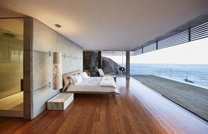 Modern luxury bedroom open to patio with ocean view - HOXF00469