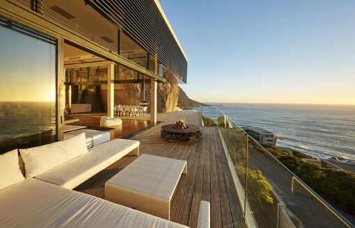 Modern luxury patio with sunset ocean view - HOXF00478