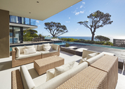 Modern luxury home showcase patio with sunny ocean view - HOXF00484