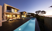 Modern luxury home showcase deck and swimming pool at sunset - HOXF00493