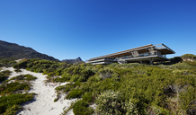Modern luxury home showcase exterior under sunny blue sky - HOXF00499