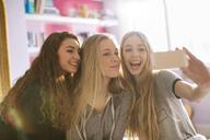 Teenage girls taking selfie with camera phone - HOXF00676