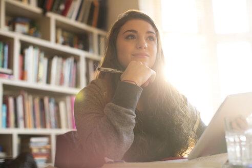 Pensive teenage girl with digital tablet - HOXF00688
