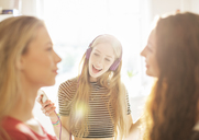 Teenage girls hanging out listening to music with headphones - HOXF00727