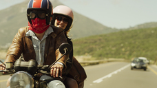 Young couple riding motorcycle on sunny road - HOXF00784