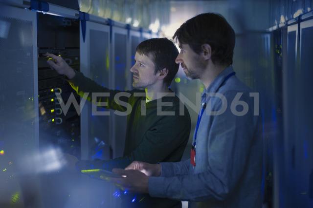Server room technicians working on panel - HOXF00847