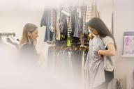Fashion buyers examining clothing - HOXF00883