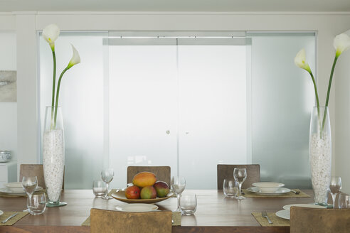 Modern dining room with lily vases in home showcase interior - HOXF00970