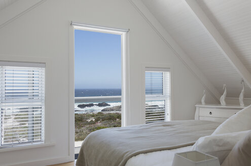 Vaulted ceiling in white home showcase bedroom with sunny ocean view - HOXF00976