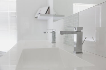 Modern white bathroom sink and faucet in home showcase interior - HOXF00994