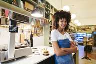 Portrait of smiling woman in a store - EBSF02212