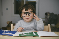 Portrait of relaxed baby girl wearing oversized glasses - GEMF01897
