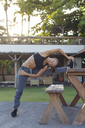 Indonesia, Bali, woman stretching - KNTF01072