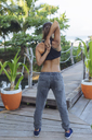 Indonesia, Bali, woman stretching arms - KNTF01078
