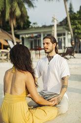 Thailand, Koh Phangan, couple practising eye gazing - MOMF00395