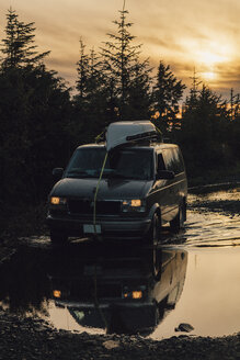 Canada, British Columbia, Skeena-Queen Charlotte A, Kaien Island, Prince Rupert, van driving through puddle in the morning - GUSF00389