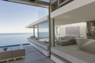 Modern, luxury home showcase living room and patio with ocean view - HOXF01029