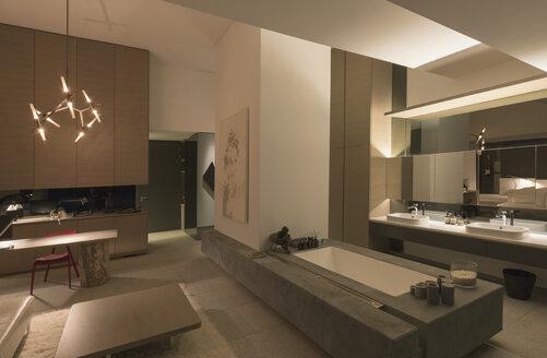 Illuminated modern, luxury home showcase interior bathroom - HOXF01092