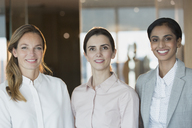 Portrait smiling, confident businesswomen in office - HOXF01146