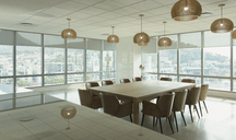 Conference table and pendant lights in modern office conference room - HOXF01173