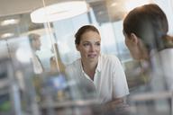 Businesswomen talking in office - HOXF01200