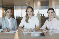 Portrait smiling, confident businesswomen working in conference room meeting - HOXF01233