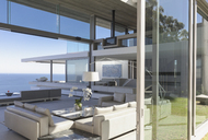 Modern, luxury home showcase interior living room with ocean view - HOXF01263