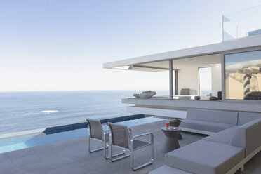 Modern, luxury home showcase exterior patio with lap pool and ocean view - HOXF01308