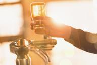 Bartender serving golden pint of beer at beer tap - HOXF01467