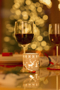 Red wine and Christmas candle on dining table - HOXF01878