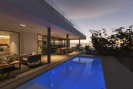 Tranquil blue lap swimming pool outside modern luxury home showcase exterior - HOXF02001