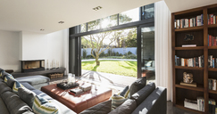 Sunny home showcase interior living room open to sunny yard - HOXF02286