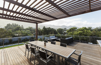 Luxury home showcase exterior wooden patio and table with mountain view - HOXF02298