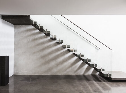 Modern, minimalist floating staircase in home showcase interior foyer - HOXF02307