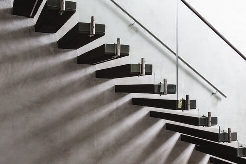 Modern, minimalist floating staircase in home showcase interior - HOXF02310