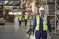 Portrait confident manager in distribution warehouse - HOXF02877