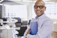 Portrait smiling businessman - HOXF02988