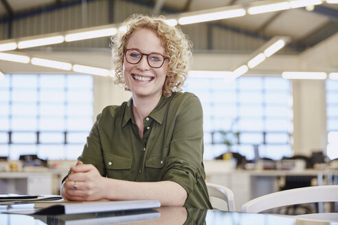 Portrait smiling businesswoman in office - HOXF03015