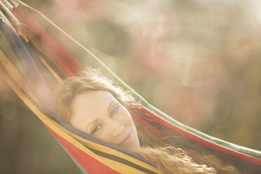 Portrait serene woman relaxing laying in hammock - HOXF03138