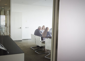 Business people meeting in conference room - HOXF03198