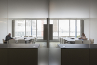 Business people working in modern symmetrical conference rooms - HOXF03201