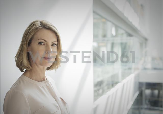 Portrait confident businesswoman in office - HOXF03219