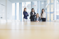Surface level portrait confident businesswoman in conference room - HOXF03258