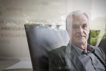 Portrait confident senior businessman - HOXF03279