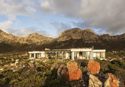 Home showcase exterior among craggy landscape - HOXF03309